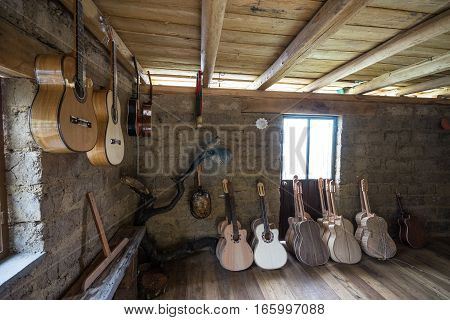 July 22, 2016 San Bartolome, Ecuador: classical guitars in various finishing stages in small rural luthier shop