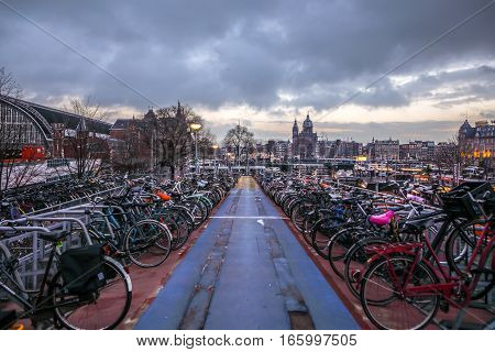AMSTERDAM NETHERLANDS - JANUARY 10 2017: Three-level parking of bicycles in Amsterdam city centre. January 10 2017 in Amsterdam - Netherlands.