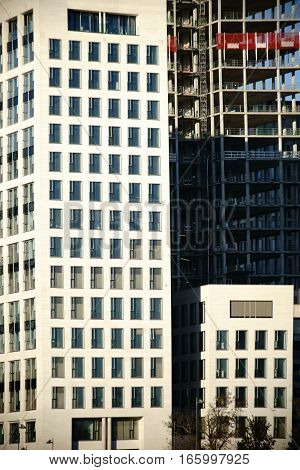 Various nested high-rise facades of old and new building complexes as well as shells.