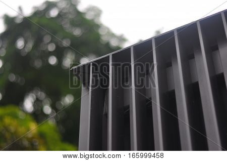 Modern facade steel edges in Architecture in dark powder coated grey.