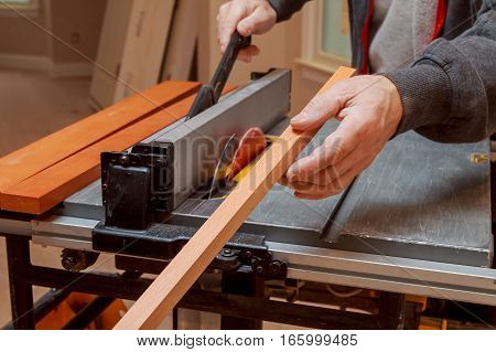 Carpenter Use Ruler To Measuring Wood Board