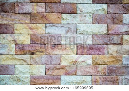 Creamy yellow walls tile stone brown with white background for the exterior.