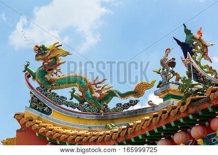 Chinese Dargon Phoenix and Crane on Taoist Temple Tiled Roof
