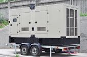 Commercial backup generator. A standby generator is a back-up electrical system that operates automatically. A standby power system may include a standby generator batteries and other apparatus. poster