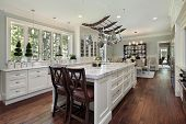 Kitchen in luxury home with white granite island poster