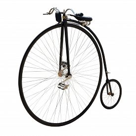 Penny-farthing or high wheel or ordinary. Bicycle with a large front wheel isolated on white.