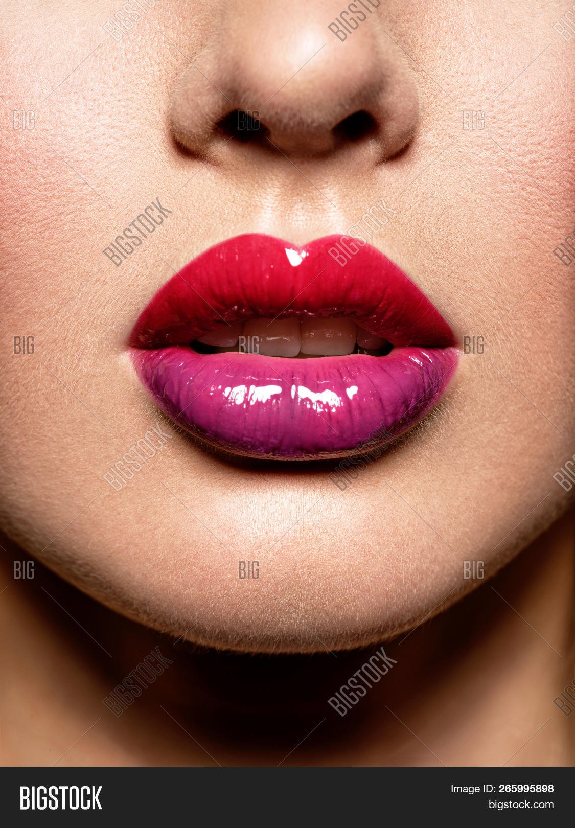 Close up view of beautiful woman lips with gloss lipstick. fashion makeup concept. Beauty
