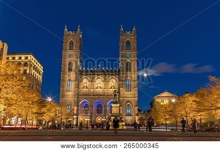 Montreal, Canada, October 20, 2018. Notre Dame Basilica From Montreal And Maisonneuve Monument Illum