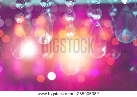 Abstract Blur Bokeh And Colourful Crystal Chandelier Light Decorate In Restaurants Or Festive Party