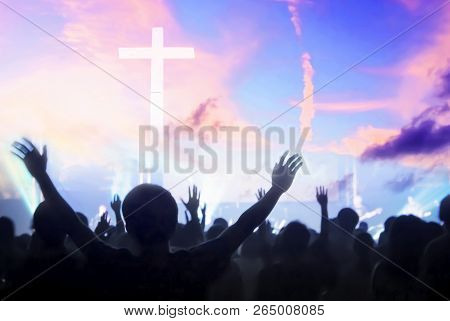 Worship And Praise Concept: Christians Worship Together And Praise God
