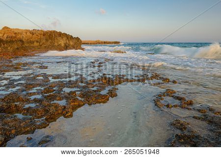 Summer Evening Over The Rocky Shore Of The Turquoise Seasummer Evening Over The Rocky Shore Of The T