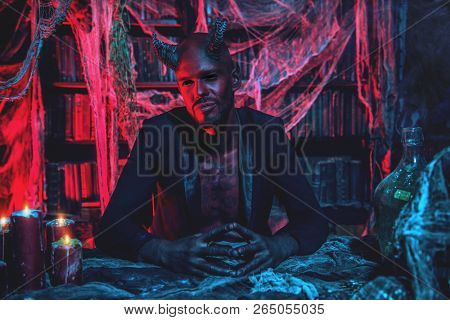 A portrait of a bad demon in his den. Horror movie, nightmare. Halloween. poster