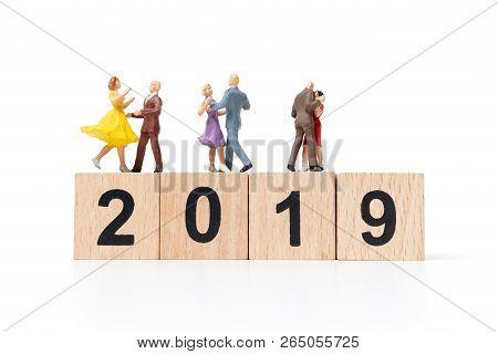 Miniature People Dancing On Wooden Block Number 2019.
