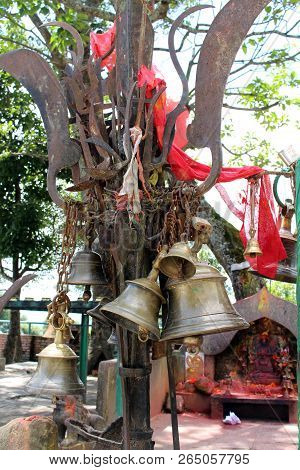 Translation: The bells and stuff at Kali Hindu Temple on top of the hill in Dhulikhel. Taken in Nepal, August 2018. poster