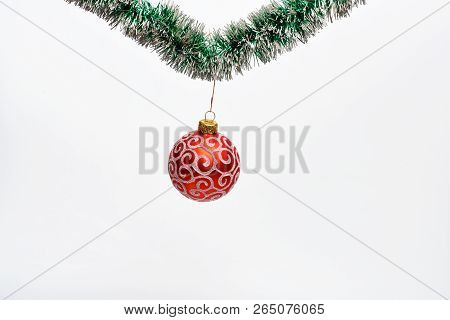 Christmas Ornament Concept. Decoration For Christmas Tree Hang On Tinsel. Tinsel With Pinned Christm