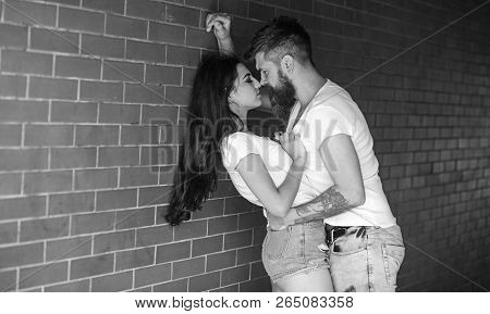 Couple Enjoy Intimacy Without Witnesses Public Place. Girl And Hipster Full Of Desire Cuddling. Coup