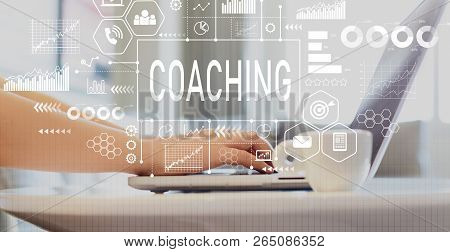 Coaching With Woman Using A Laptop On A Coffee Table
