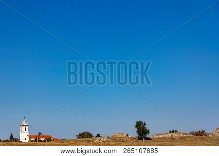 An Isolated Church Near Conimbriga In Portugal Under A Cloudless Blue Sky