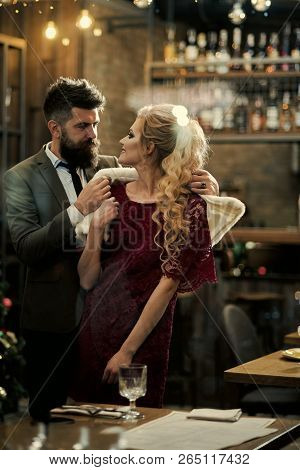 Business Meeting Of Man And Woman. Couple In Love Meet At Restaurant. Valentines Day With Sexy Woman