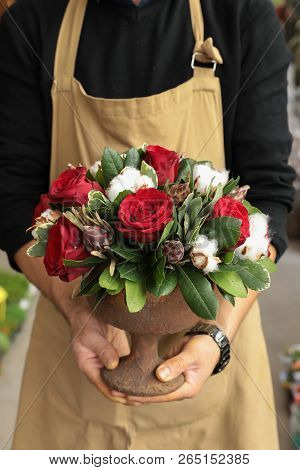 Festive Flower Arrangement Of Red Roses And Cotton Flowers In The Vase Florist Holding At The Flower