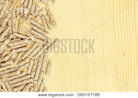 Wood Pellets On Wooden Board With Copy Space