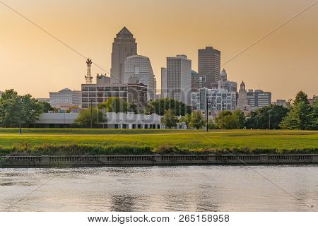 City Skyline Of Des Moines, Iowa Across The Racoon River At Sunset