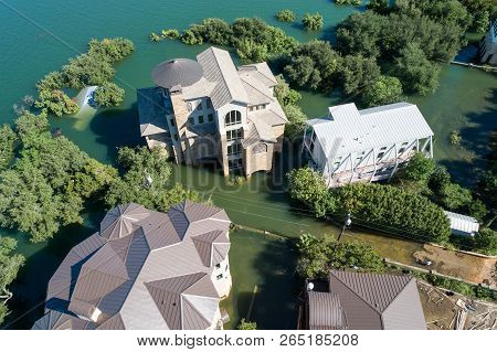 Aeriaal Drone View Above Flood Damage Huge Mansion Homes Under Water After Major Climate Change Floo
