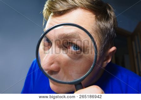 A Suspicious Man, Skeptic Expression, Inquisitive Man, Portrait of a Man Peeping, Funny Picture, Wide-Angle, Studio Shot, Man to Investigate Suspicious poster