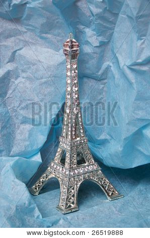 Kitch Eiffel tower in false diamonds on blue tissue paper poster