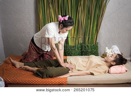 Thai Masseuse Doing Massage For Lifestyle Woman In Spa Salon. Asian Beautiful Woman Getting Thai Her