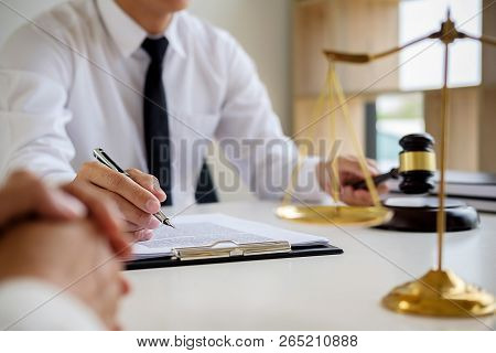 Justice And Law Concept. Legal Counsel Presents To The Client A Signed Contract With Gavel And Legal