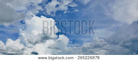 Dramatic deep blue sky with puffy white clouds in bright clear spring day times. poster