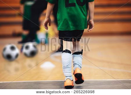 Kids Futsal Training. Indoor Soccer Players Training With Balls. Sport Background. Indoor Soccer Spo
