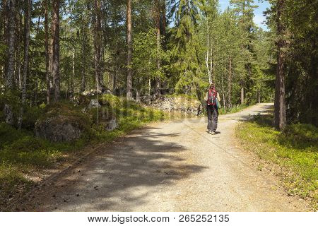 Medelpad, Sweden On July 06. View Of A Backpacker Along A Trail In The Woodland On July 06, 2018 In