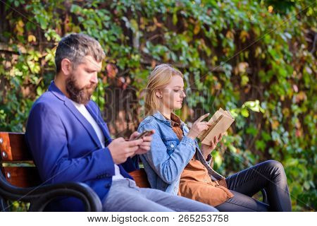 Read Book In Park Pleasant Leisure. Interesting Literature. Woman Read Book While Man Read Ebook Sma