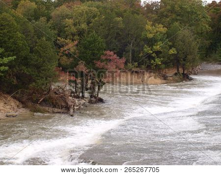 Water From Another Day Of Rain Is Rushing Over The Main Dam And Its Primary Spillway Into The Two Ch