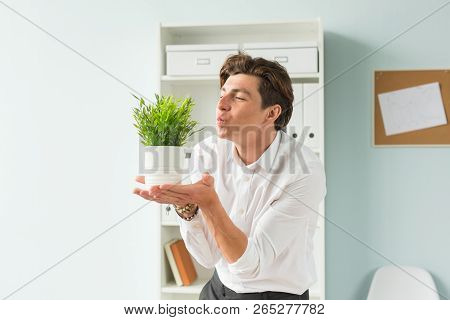 Fun, Business And People Concept - Handsome Man Blowing At Plant In His Office, Joke, The 1st Of Apr