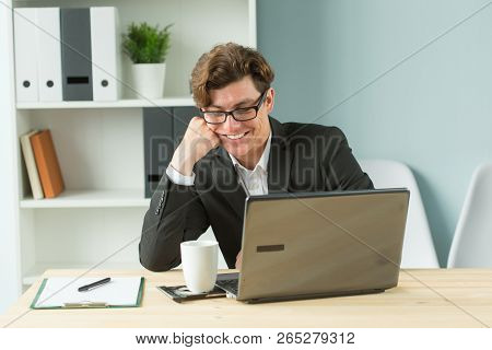 Business People, Humor And Fun Concept - Handsome Office Man Laughing At Workplace