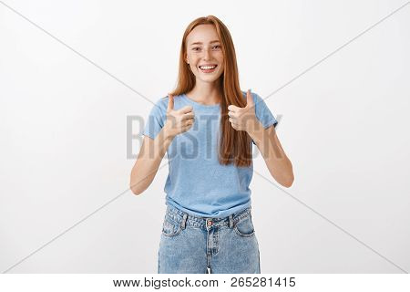 Totally Agree And Support You. Portrait Of Joyful Pleased Good-looking Redhead Female With Freckles
