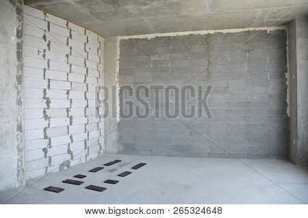 Interior Room Under Construction. Wall Without Stucco And Plasterwork.