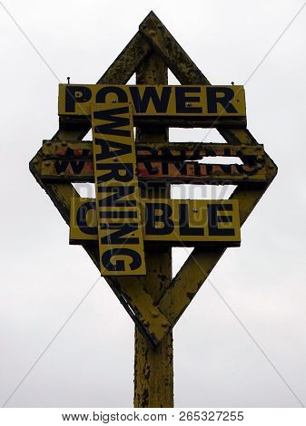 A Decrepit Warning Post Advising A Telephone Cable Is Underground