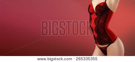 Beautiful Sexy Woman In Fashion Red Lingerie Corset. Valentine Day Erotic Style. Passion Horizontal