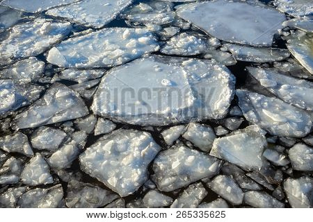 Ice floes on the river on a cold winter day at sunset