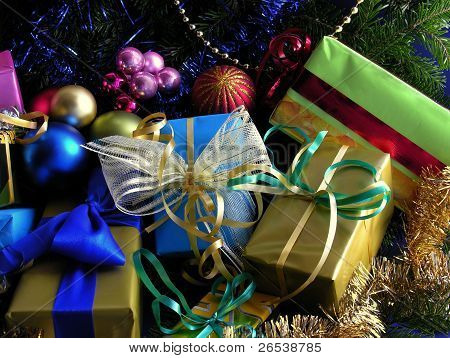 decorated Christmas tree and traditional gifts