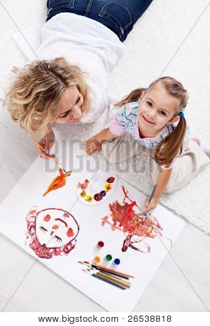 Painting with mom - little girl with brush and colors