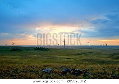 Wind Power Stations. A Wind Farm Is A Group Of Wind Turbines In The Same Location Used For Productio