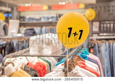 Selling Goods In The Store. Buy One And Give Another. 1+1.