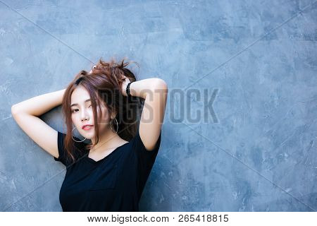 Portrait Charming Beautiful Woman. Attractive Beautiful Women Puts Up Her Hair. Gorgeous Woman Get R