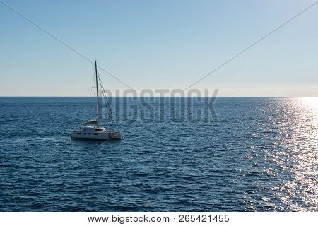 White Sailing Boat In Malta Traveling To Gozo On A Bright Sunny Summer Day In The Middle Of Nowhere.