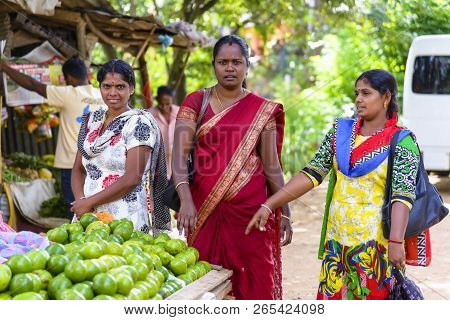 Divithotawela, Sri Lanka - August 20, 2017: Three Unidentified Women In Traditional Clothes Are Shop
